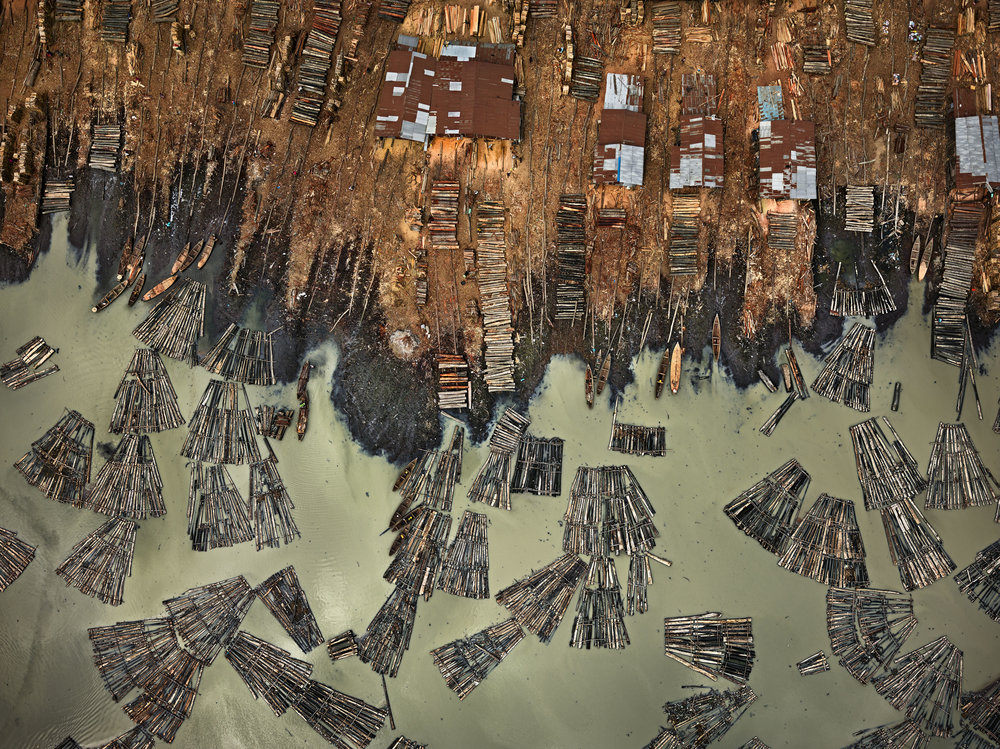 "Edward Burtynsky. ""saw Mills #1, Lagos, Nigeria"" (2016). Photo(s) © Edward Burtynsky. Courtesy Robert Koch Gallery, San Francisco / Nicholas Metivier Gallery, Toronto."