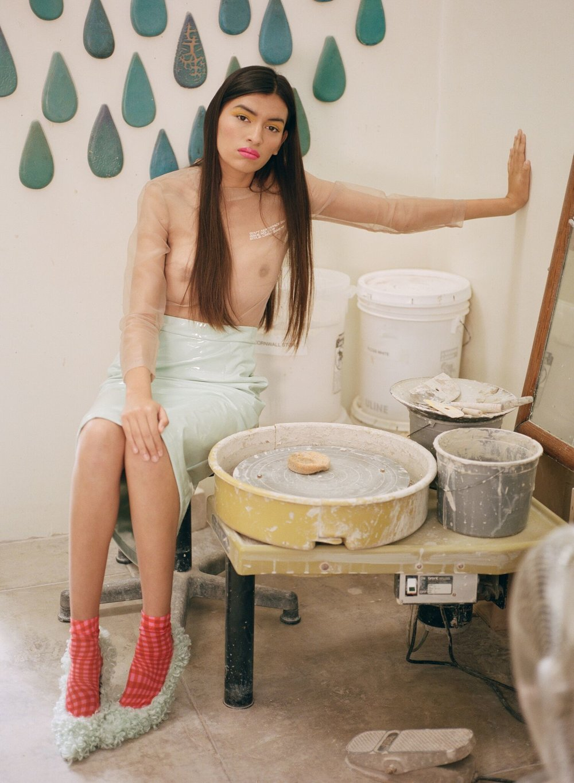 IH NOM UH NIT     top,   ANNA KIKI     skirt and shoes, and   MOLLY GODDARD     socks.