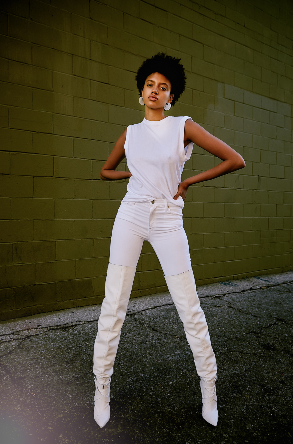 AGOLDE   top,   HUDSON   jeans,   MSGM   boots,   ACCESSORY CONCIERGE   earrings.