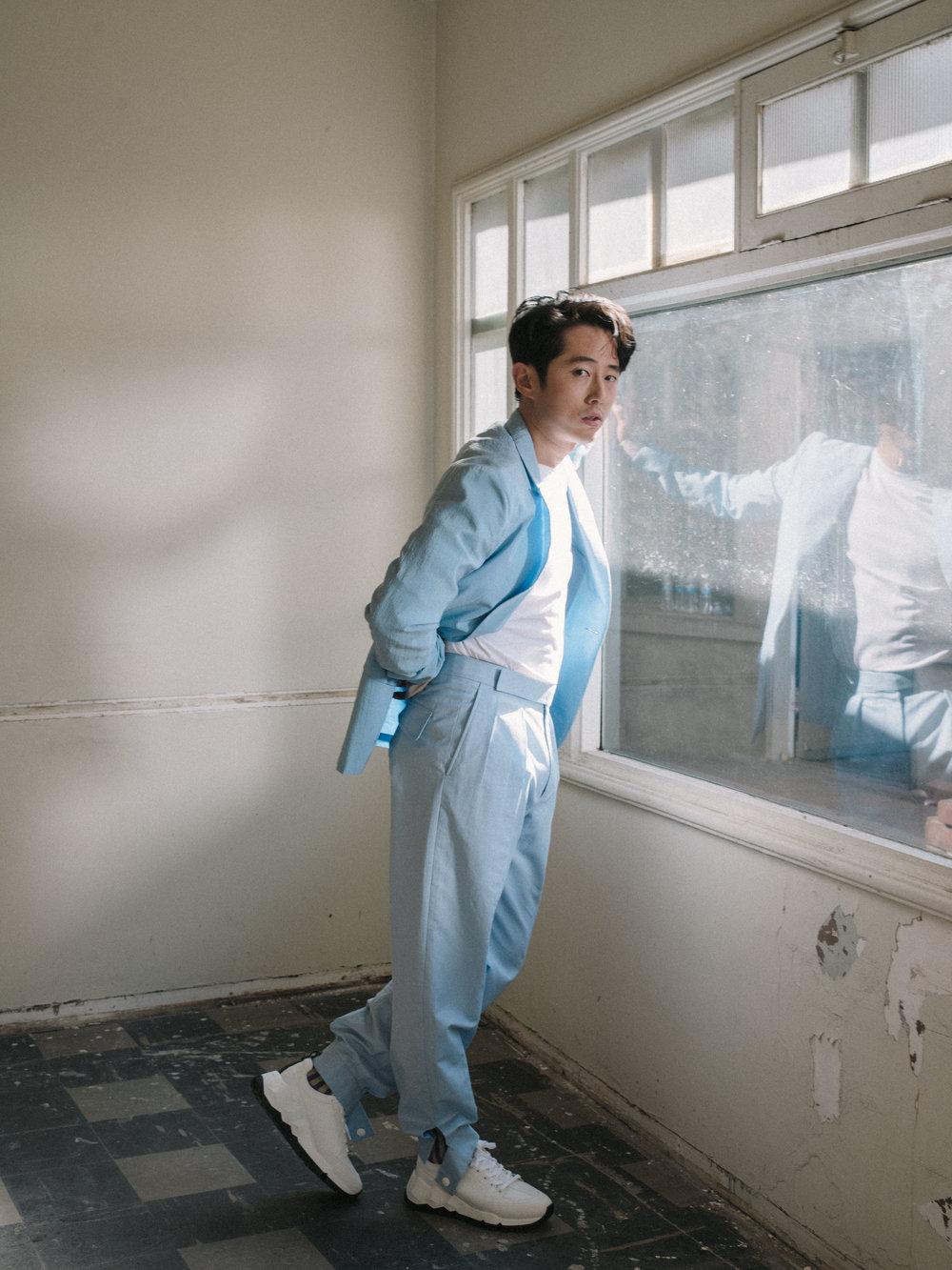 ERMENEGILDO ZEGNA COUTURE   suit,   BASSIKE     shirt,   PIERRE HARDY     shoes, and   LU CHUNG     socks.