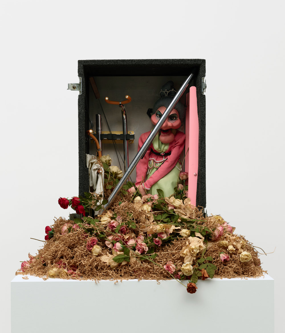 Nayland Blake    Magic , 1990-91  Puppet, steel, paper, wood, nylon straps, artificial flowers, and carrying case  33 3/4 x 42 5/8 x 41 3/4 inches  86 x 108 x 106 cm