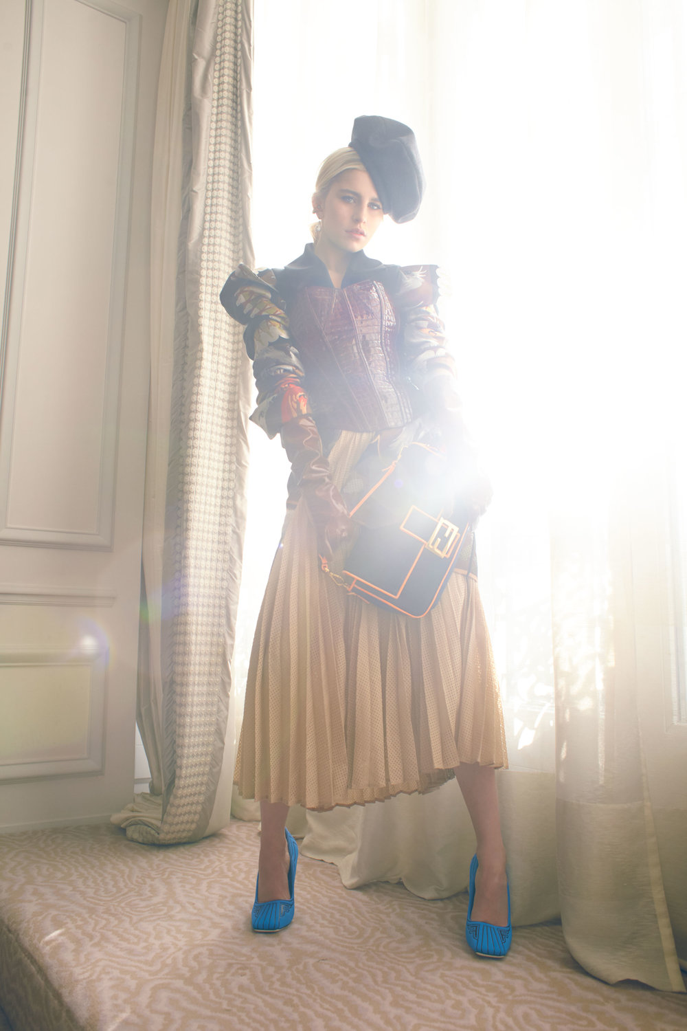 FENDI     coat, jacket, skirt, shoes, and baguette and stylist's own bustier and hat.