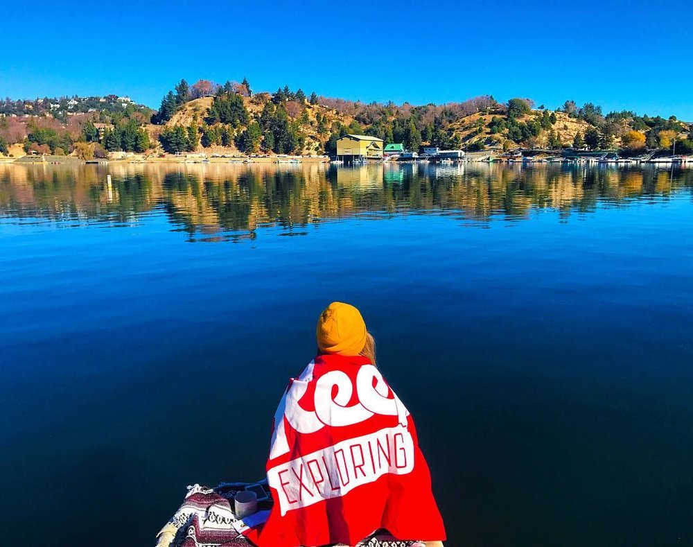 Crazy times call for peaceful reflections, like @aubreeplodinec at Lake Arrowhead