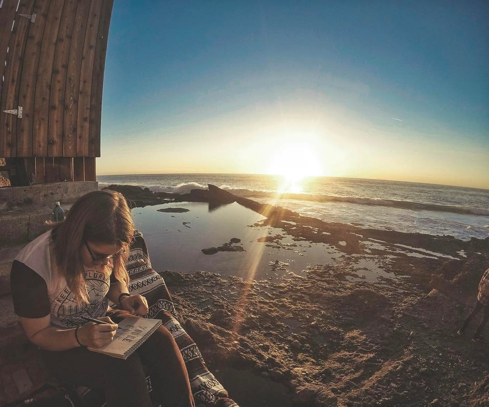 Our pal @jenmatichuk sketches in the sunset with @aubreeplodinec at Thousand Steps Laguna Beach