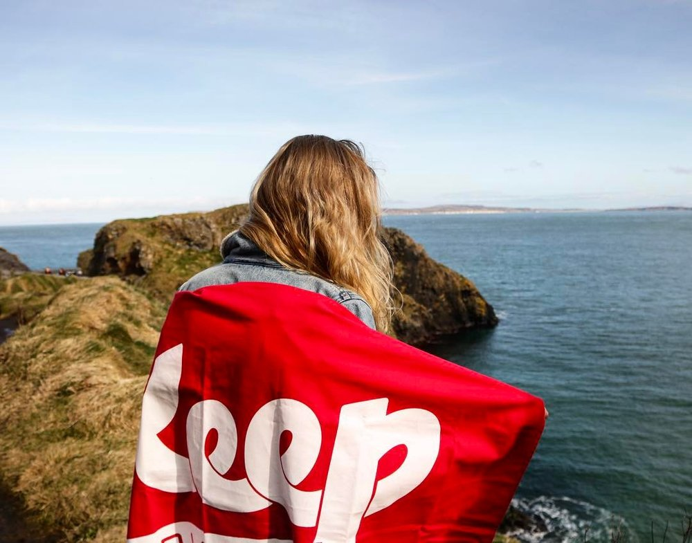 @dickinson_jj posing with the flag at Carrick-a-Rede Rope Bridge
