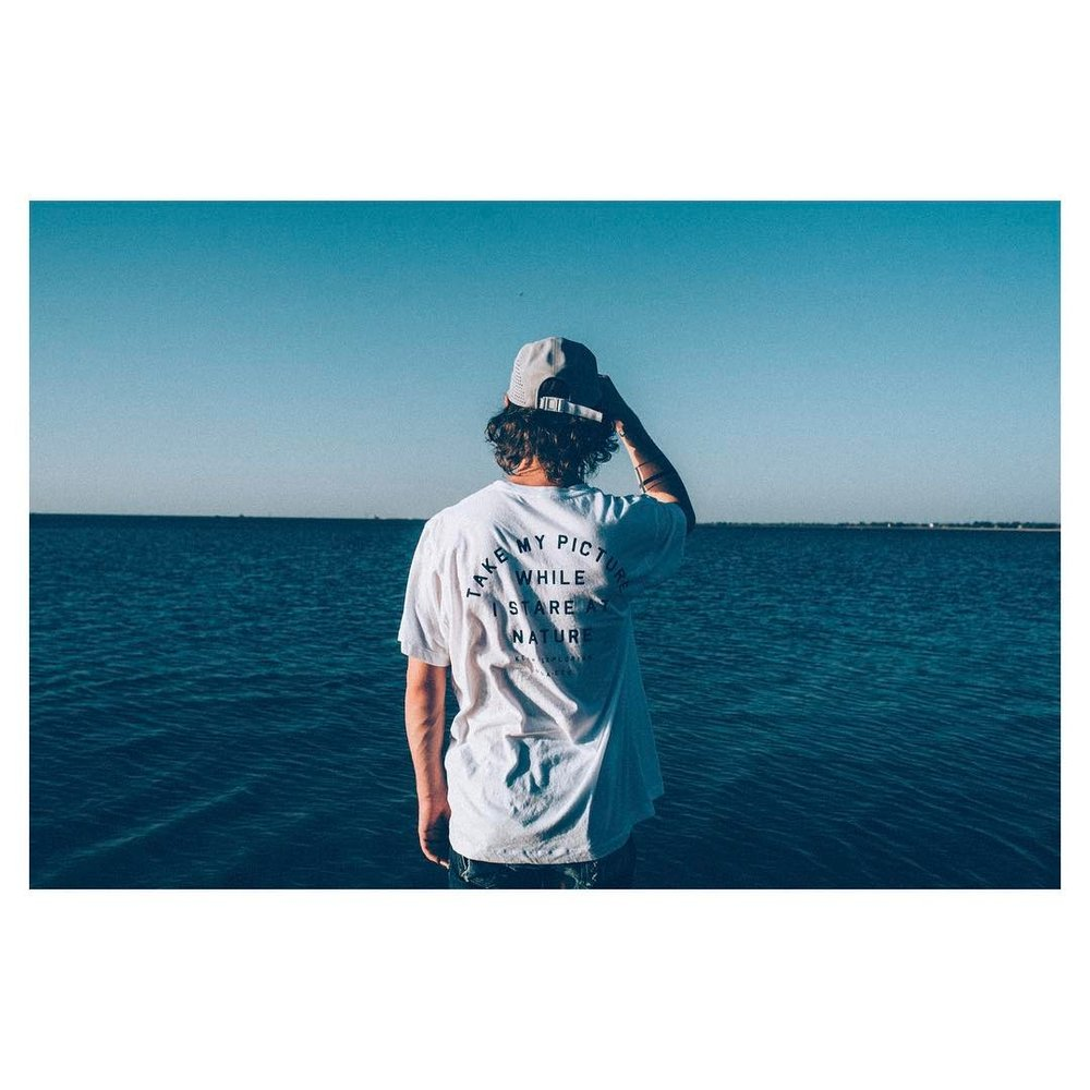@t_rummy poses perfectly in our favorite tee for @mzweidemann on Lake Hefner