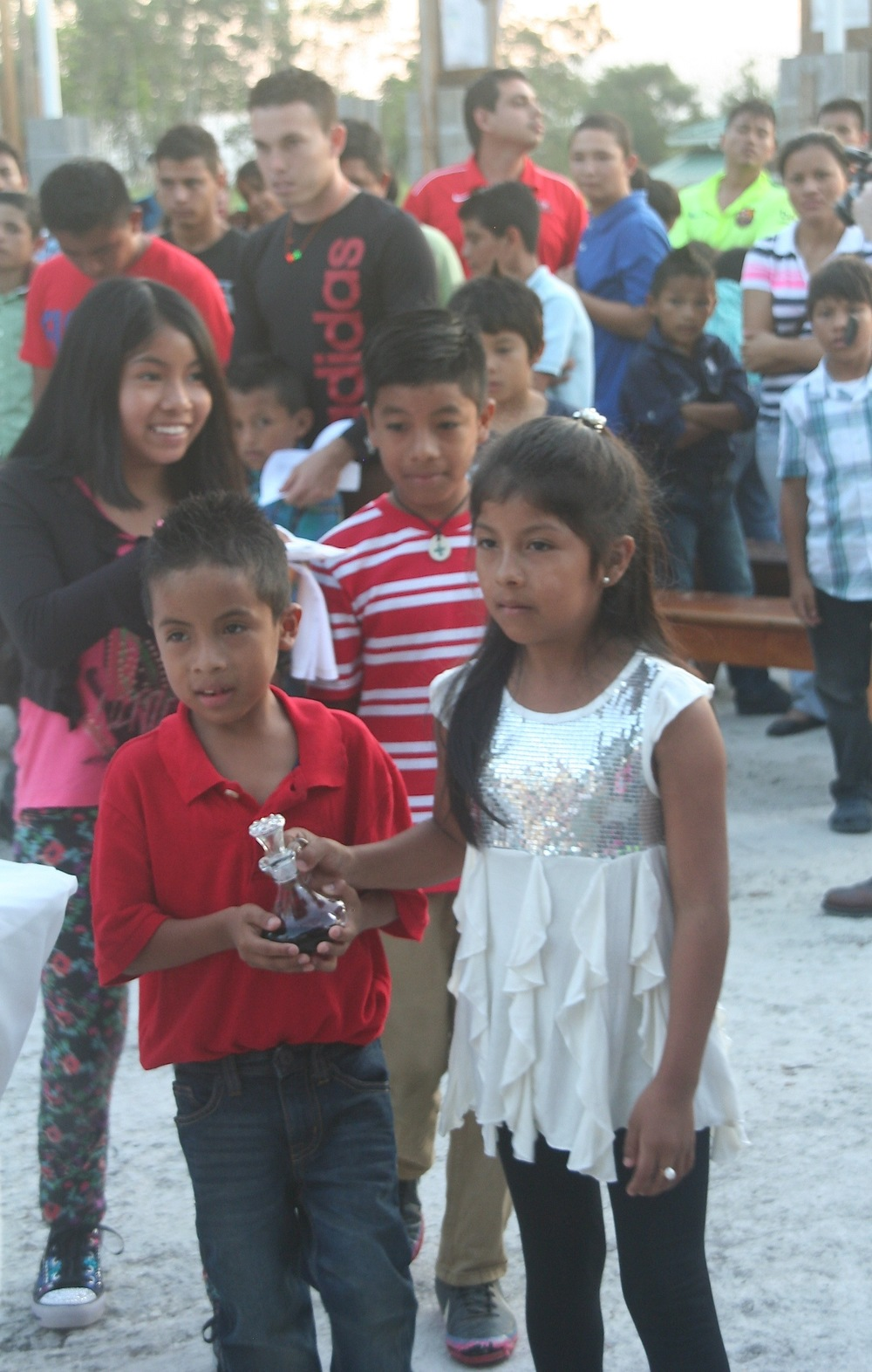 Carmen* and her siblings presenting the gifts at a mass with Fr. Dennis in January.