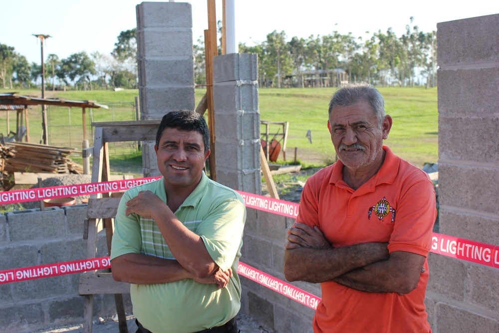 Padrino Ubil and Don Mito at the construction site of what will soon be the Amigos de Jesús chapel.