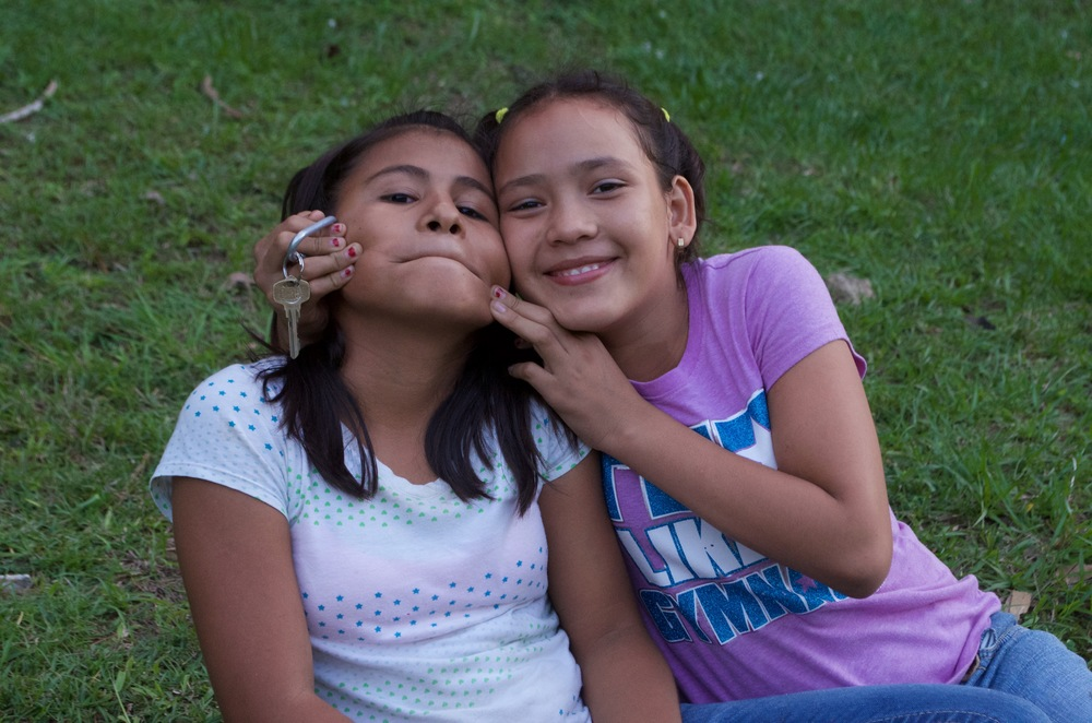 Valeria (left) and friend having fun while watching a soccer game at Amigos.