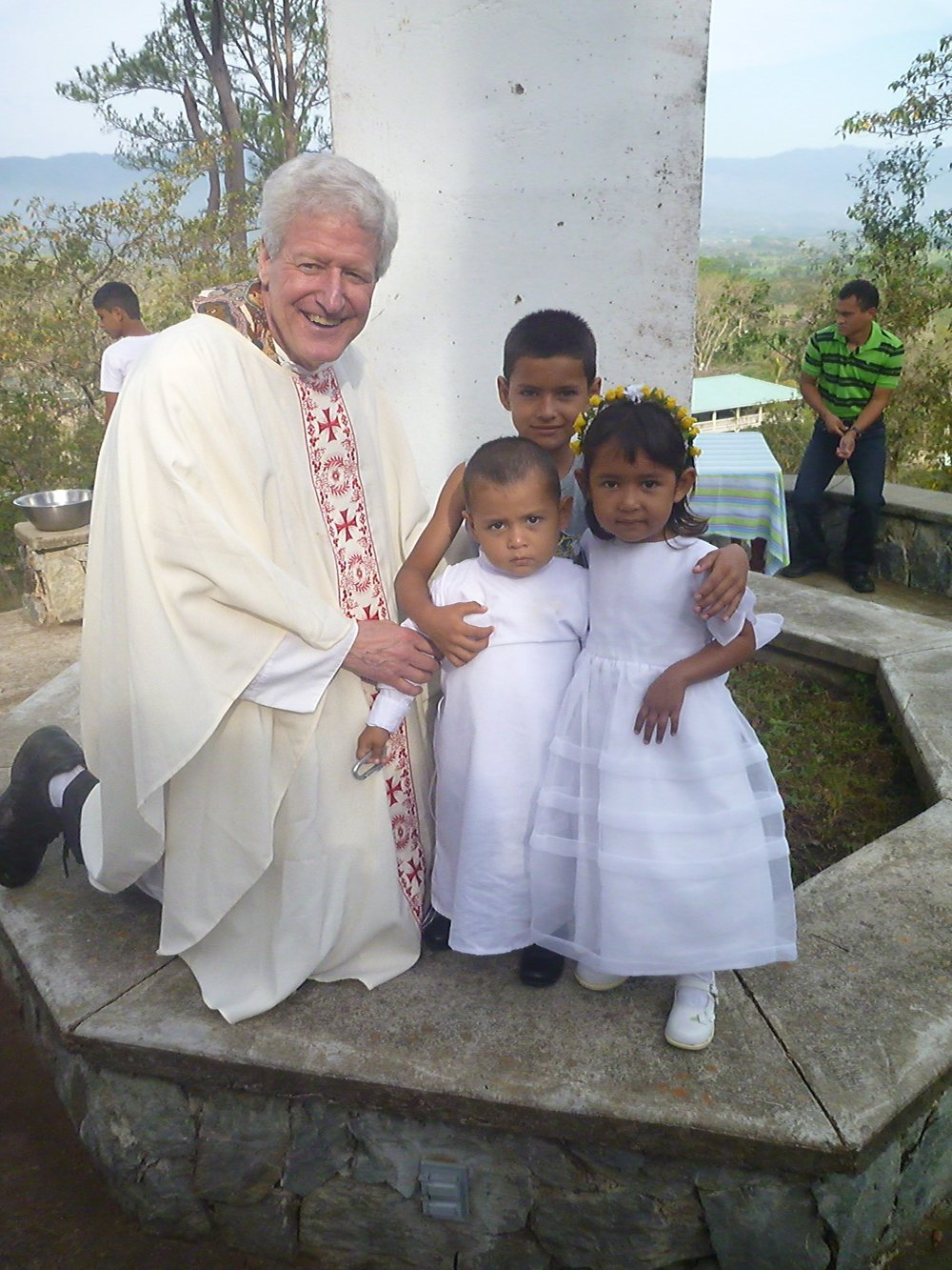 Perla and her brothers with Fr. Dennis not long after their arrival
