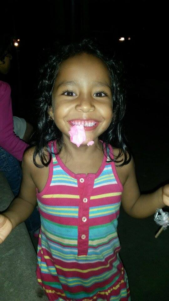 Kira* enjoying cotton candy and flashing her signature smile!