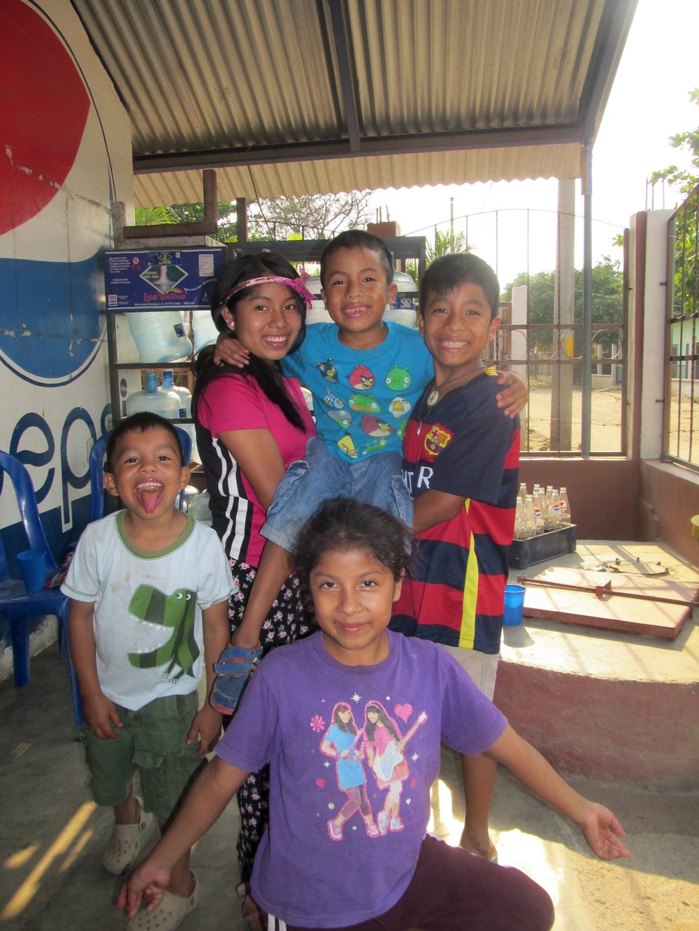 Herndando (upper right) with his three siblings and a friend (white and green dinosaur shirt)
