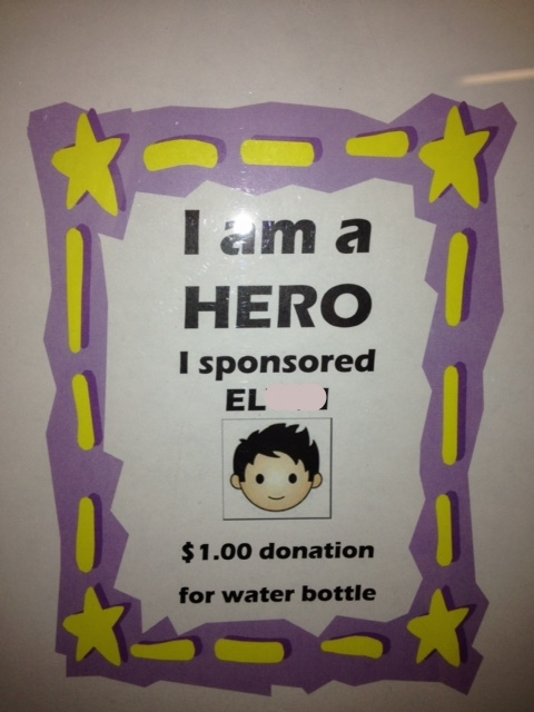 This is a water bottle sale sign that we have in our office. We sell water to raise money for the pizza that we purchase when we arrive in Honduras. After arriving in the airport, we order hundreds of slices of pizza and bring it to the hogar on our visits! The water sales are unbelievably popular and we raised several hundred dollars over the year.
