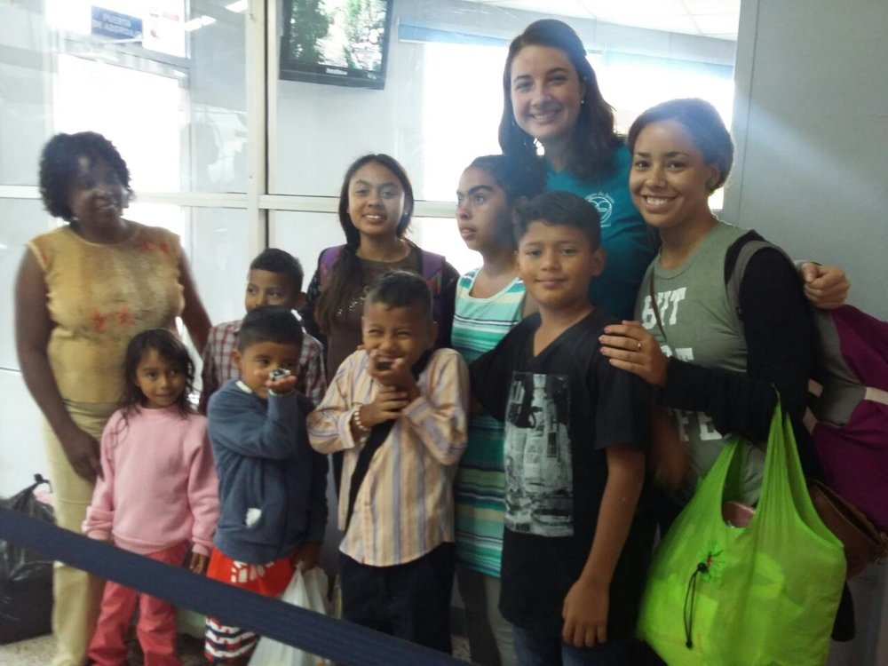 Miss Stephanie (far right) and Miss Ashley on their trip to Tegucigalpa with the kids in October. Here, they are also joined by one of the caretakers at their old home.