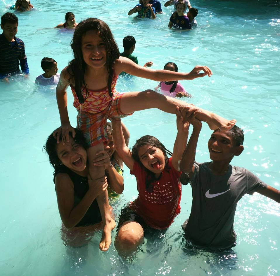 Fun with friends at the waterpark near Amigos! (Catalina is the top child)
