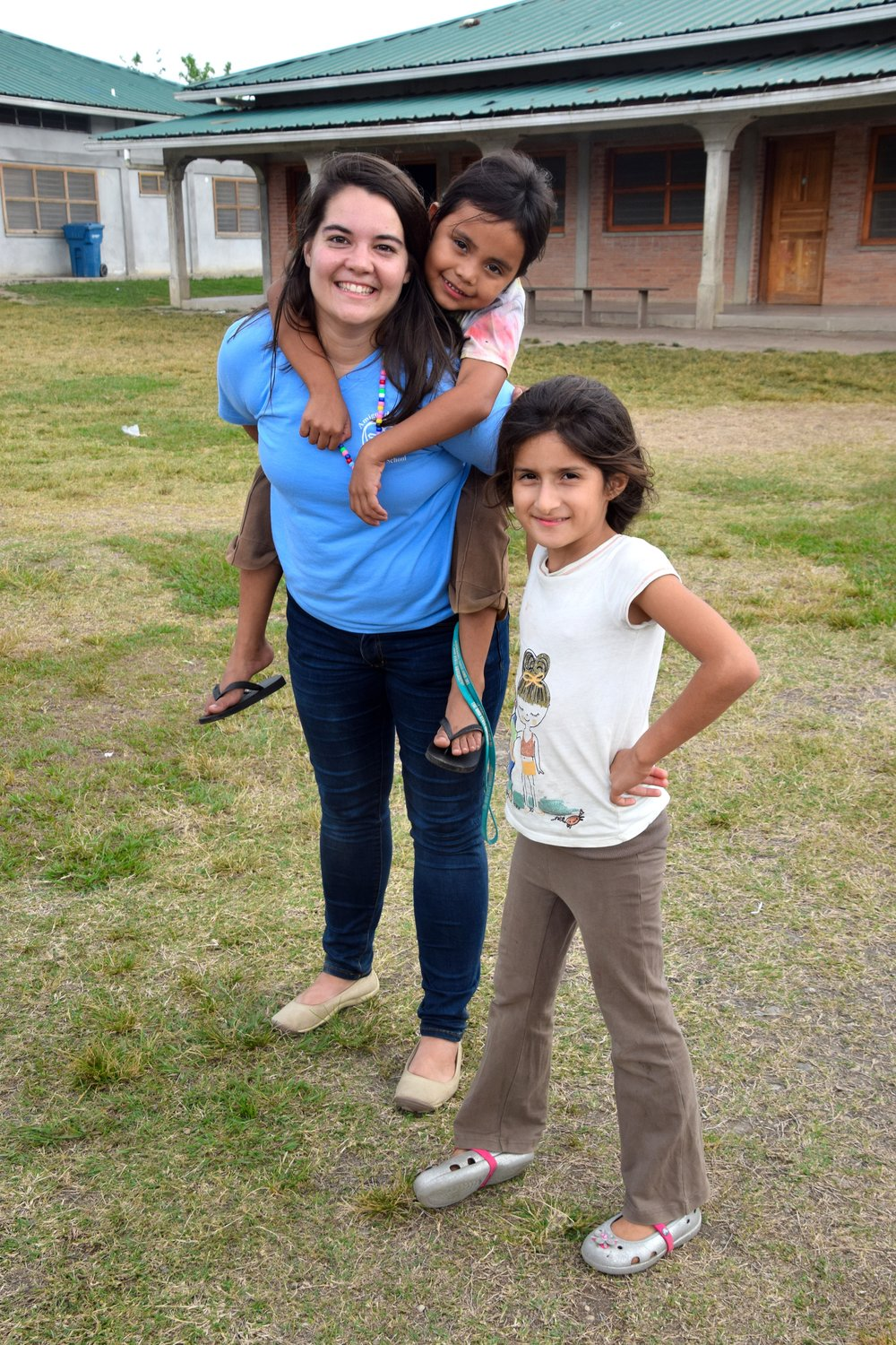Catalina (front right) and Miss Audra (2015-17 volunteer)
