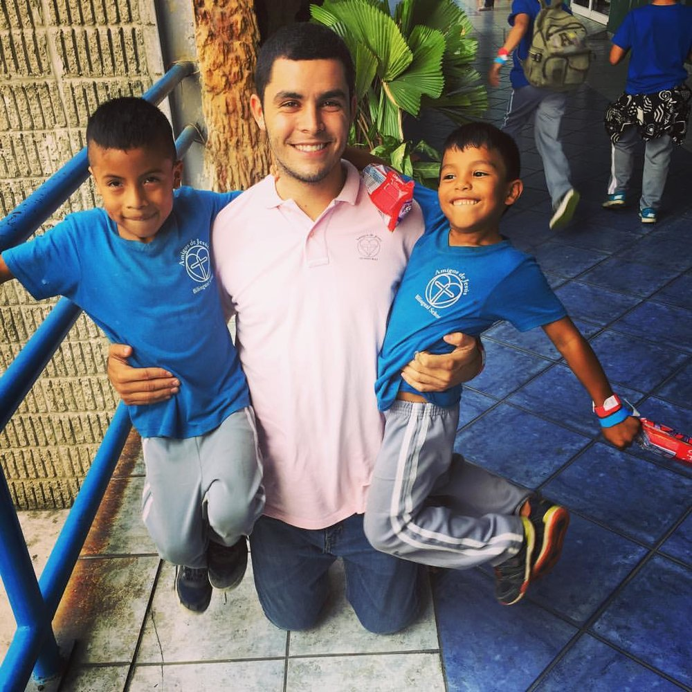 Matias (left) with Mr. Zack and a friend on a school field trip in April 2017