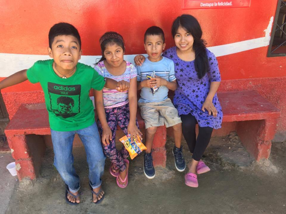Matias (blue shirt) and his three older siblings who also live at Amigos