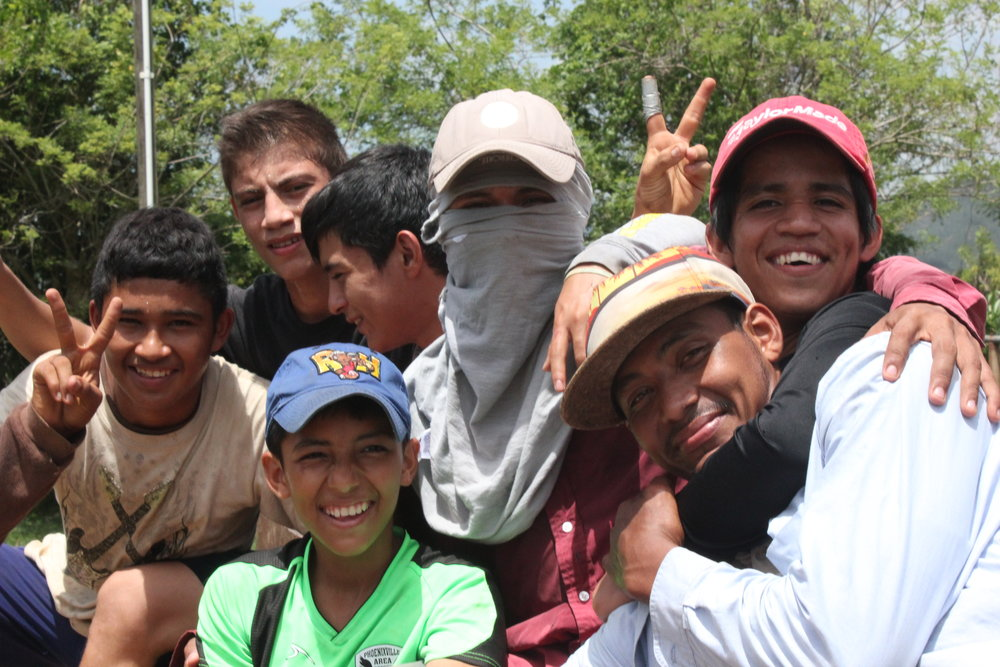 Adán (left) and his friends from 'agro.'