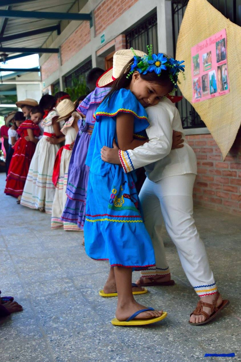Dancing a traditional dance at the celebration for Honduran National Identity Day in June 2017