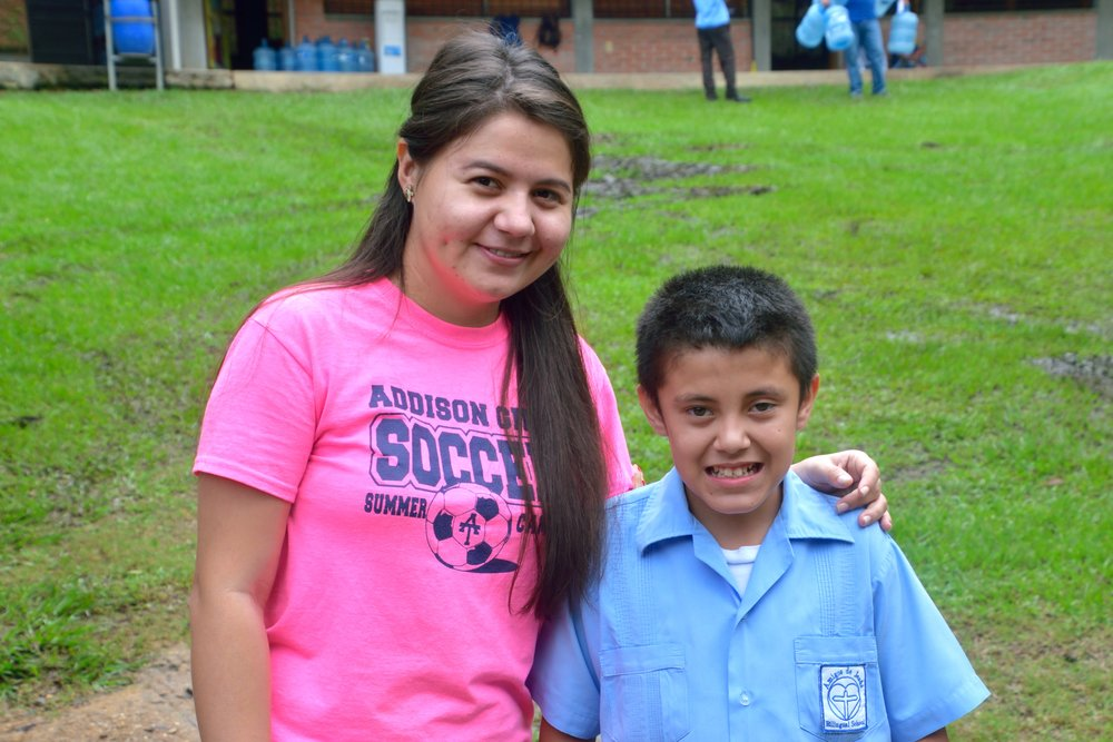 Profe Gabriela with one of the students in the BECA Bilingual Program.