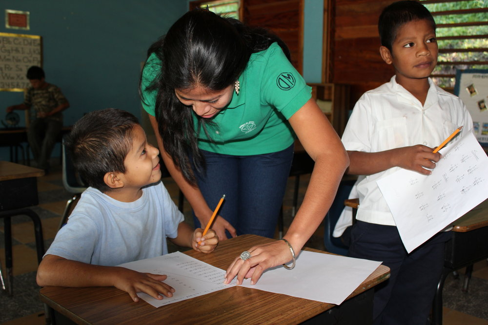 Jason in 2012 with his teacher, Profe Ana, who still works at the Amigos de Jesús Bilingual School today.