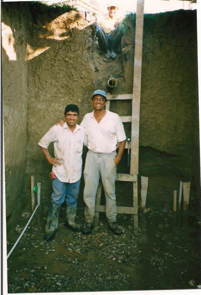 Ubil with co-founder Anthony Granese working on a construction project in the earliest years of Amigos.