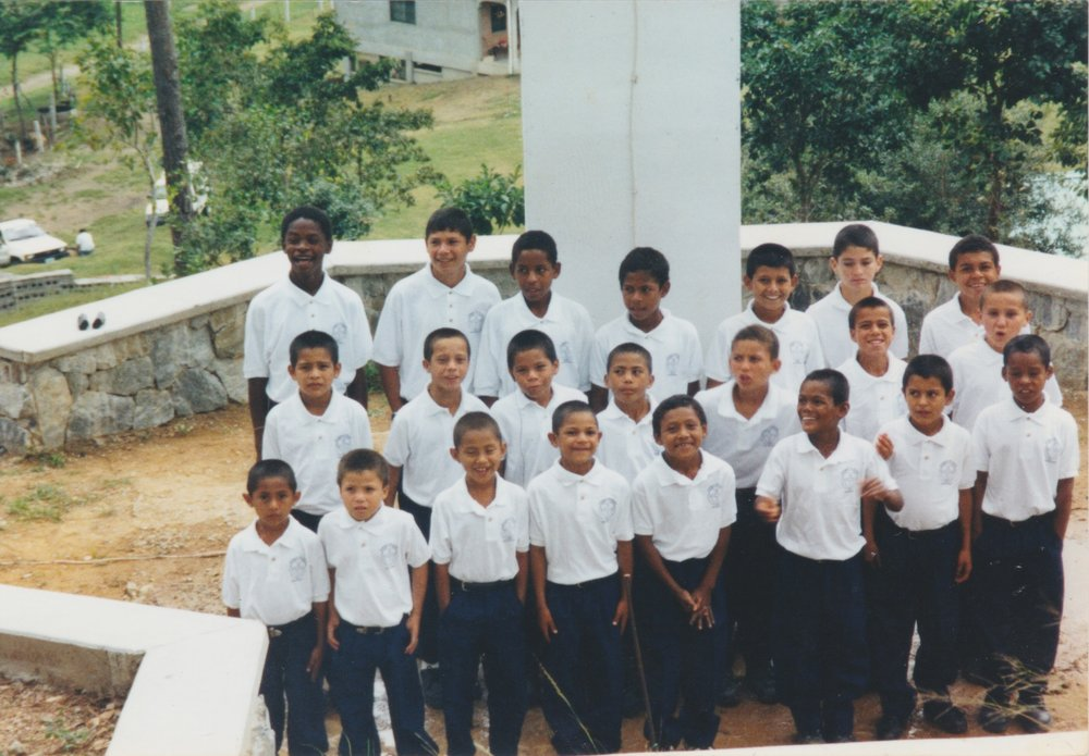 Martin pictured in the back row, all the way on the left in the early 2000's.
