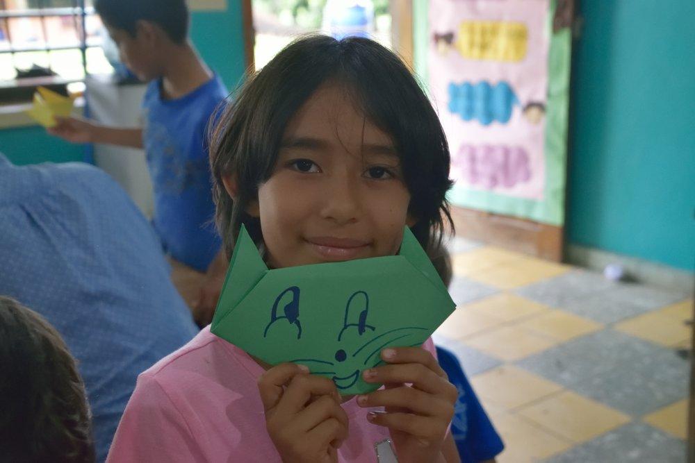 Perla working in her origami class during after school activities.