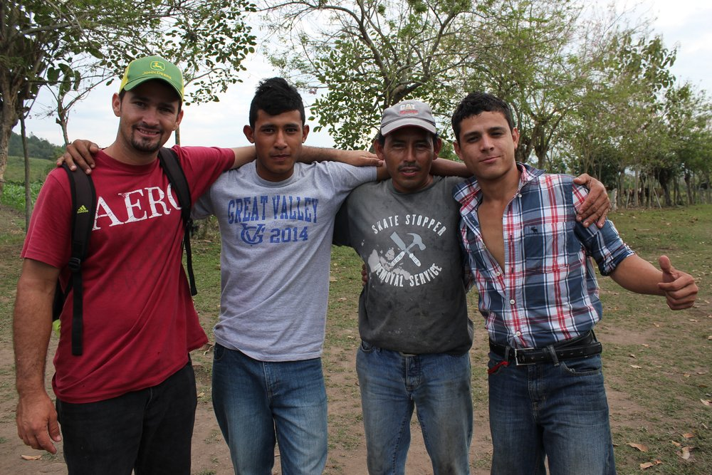 Sergio, in the red shirt on the left, with one of the employees that works in 'agro' and two of the 'jovenes' that help out in 'agro.'