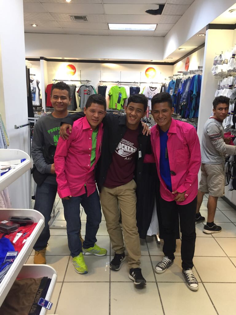 Vicente (in the pink shirt on the right), pictured with several of the other 'jovenes' who also turned 18 this year, shopping for new shirts for their 18th birthday celebration.