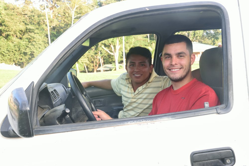 Mr. Zack (pictured in the red shirt) and one of the 'jovenes' driving around the 'hogar' one morning helping with trash duty.