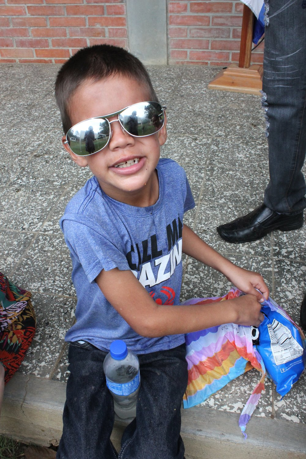 Domingo enjoying 'merienda' (snack) at Visitor's Day in March of 2016.