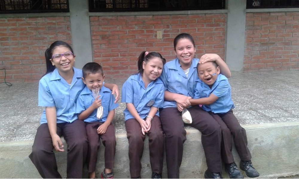 Elisa, pictured on the left, with her four siblings, posing for a picture at school last year.