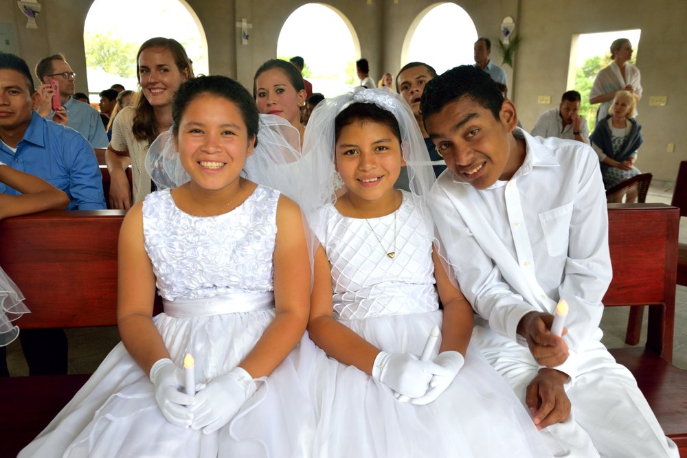 Elisa, pictured in the middle, during Semana Santa (Holy Week) in April of 2017, when she received her First Holy Communion.