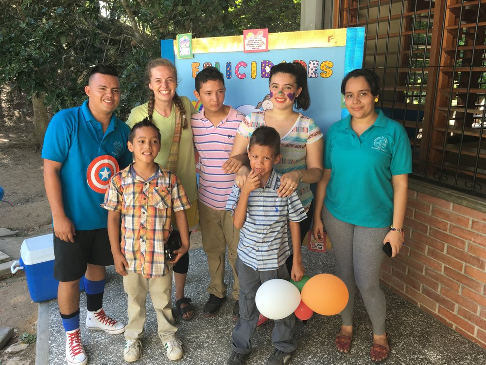 Domingo, in the blue striped shirt in the front, with several of his classmates and teachers at Día del Niño (Children's Day) in 2016.