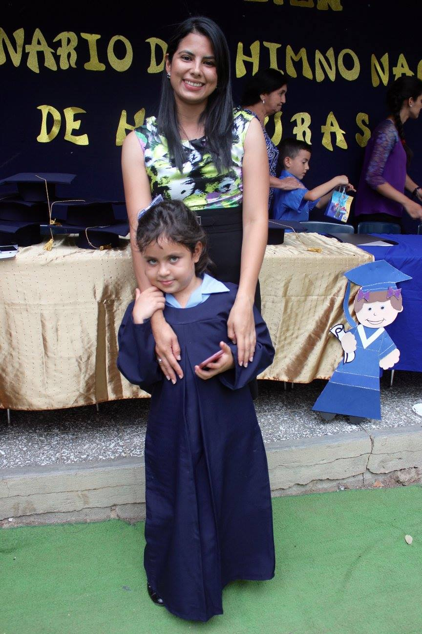 Cinthia at her graduation from 'Prepa' (Kindergarten) with one of the 'madrinas' she is close with.