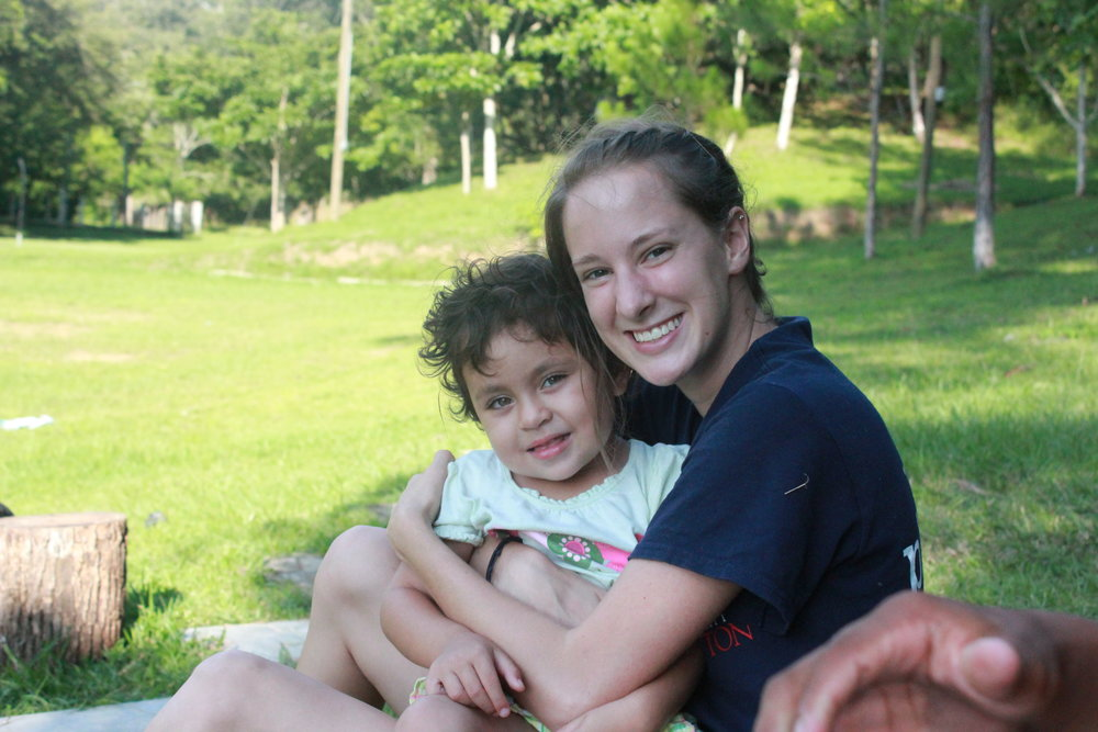 Cinthia posing with a volunteer cerca 2012.