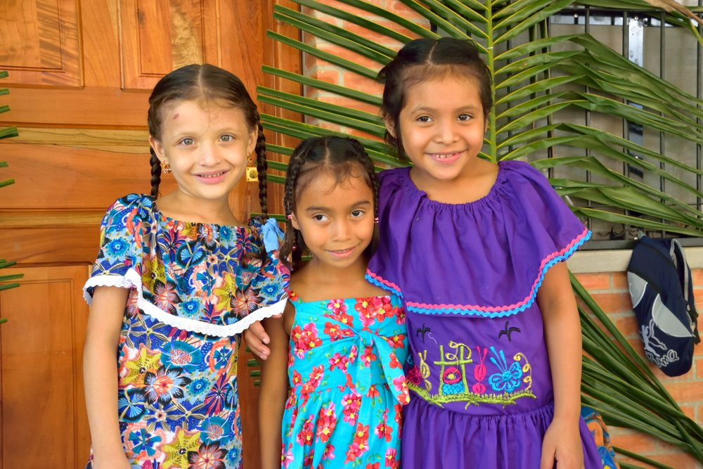 Celebrating 'Día del indio Lempira', or Lempira Day with some of her classmates at the Amigos de Jesús Bilingual School last June.