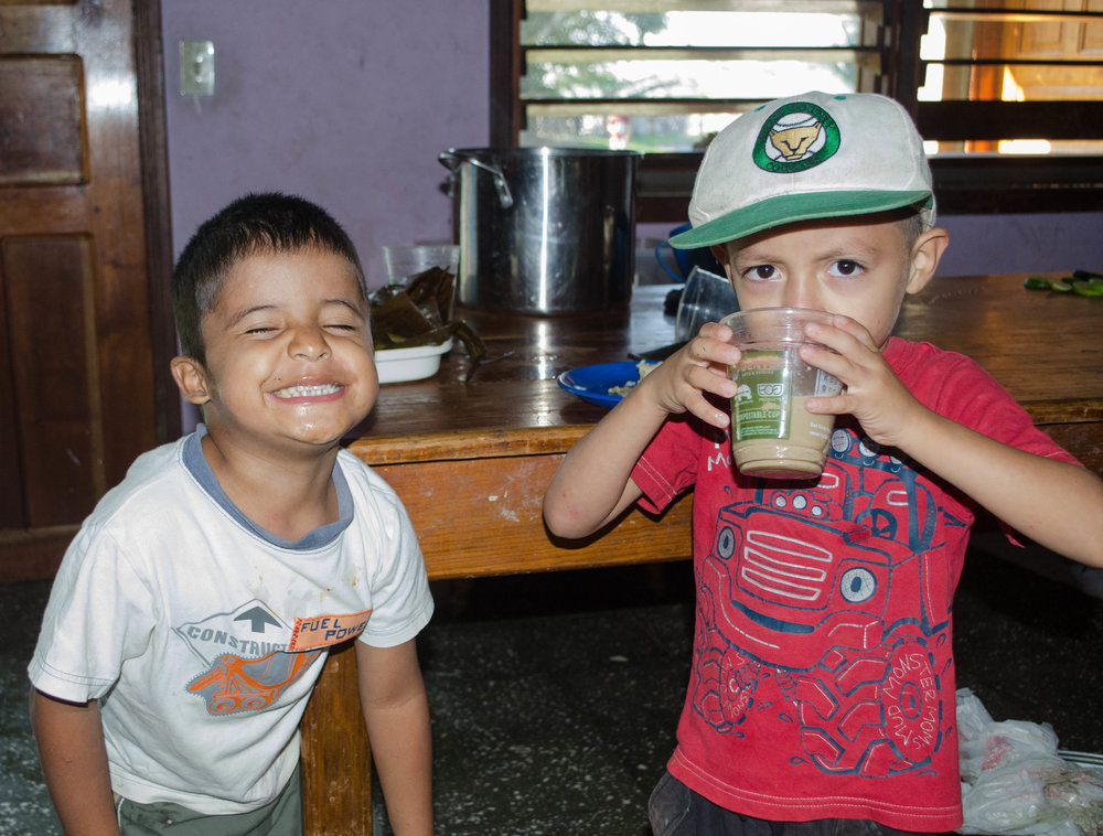 Enjoying a snack and some to time to be silly with one of the boys in his hogar a few years ago.