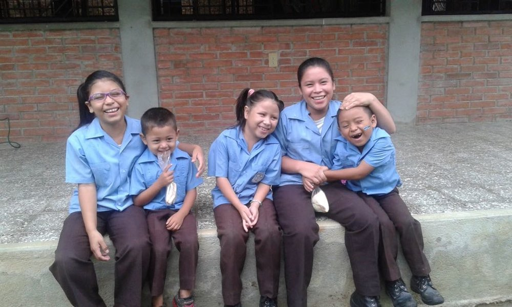 Agustin with his four siblings at school, 2016