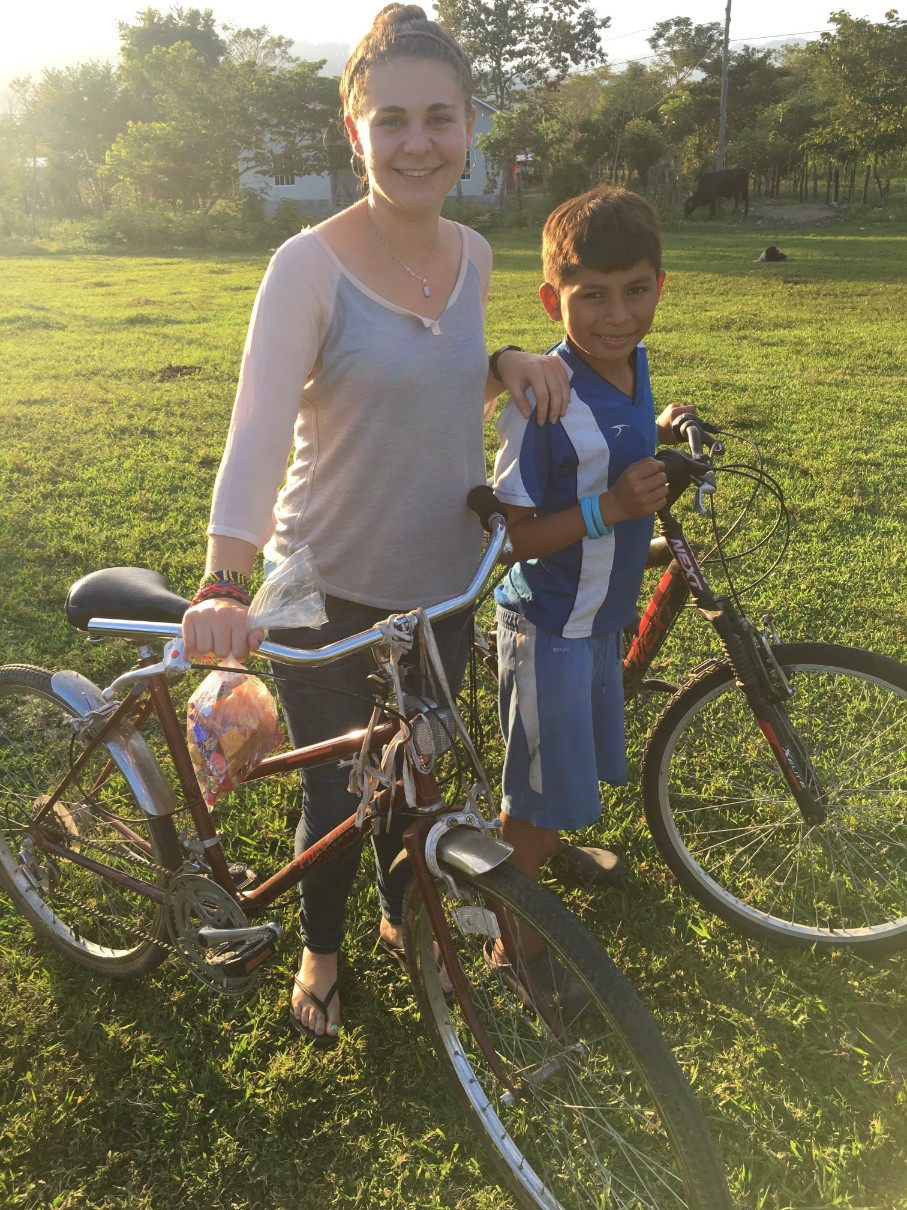 Bringing out the bikes to take on the birthday walk with one of the boys from her 'hogar'