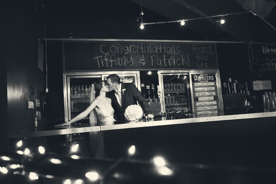 tiffany and patrick behind bar