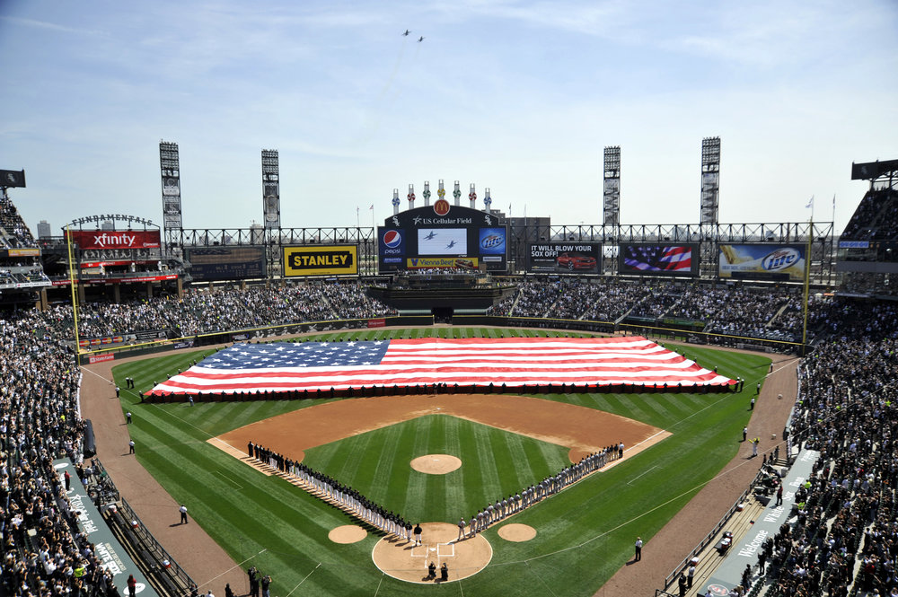 US_Navy_100406-N-1232M-001_Sailors_assigned_to_various_commands_at_Naval_Station_Great_Lakes_unfurl_an_American_flag_before_the_2010_home_opening_Chicago_White_Sox_baseball_game.jpg
