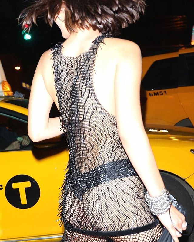 From 'then' to 'now'. Bella Hadid. From behind. at the #metgala2017. No one can deny that the girl has allure, but having seen her celebrity star rise on the back of whom she is kissing and who she is pseudo-lesby-kissing on any given day, on the back of any given millionaire yacht, at what cost does her superstardom exist?⠀ ⠀ I chose this image actually because I ADORE it. I think its beautiful and candid, and the colours are lovely and the POV sneaky bum flash covered in jet black sequins keeps me awake at night.⠀ ⠀ Beautiful? Classy? Who cares? What are your thoughts?  #nofilter #sexy?