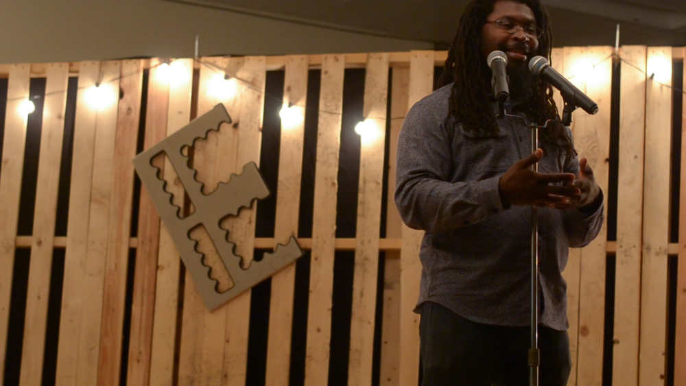 Voice Porter hosting the inaugural Poetry Open Mic Night at the Jazz House