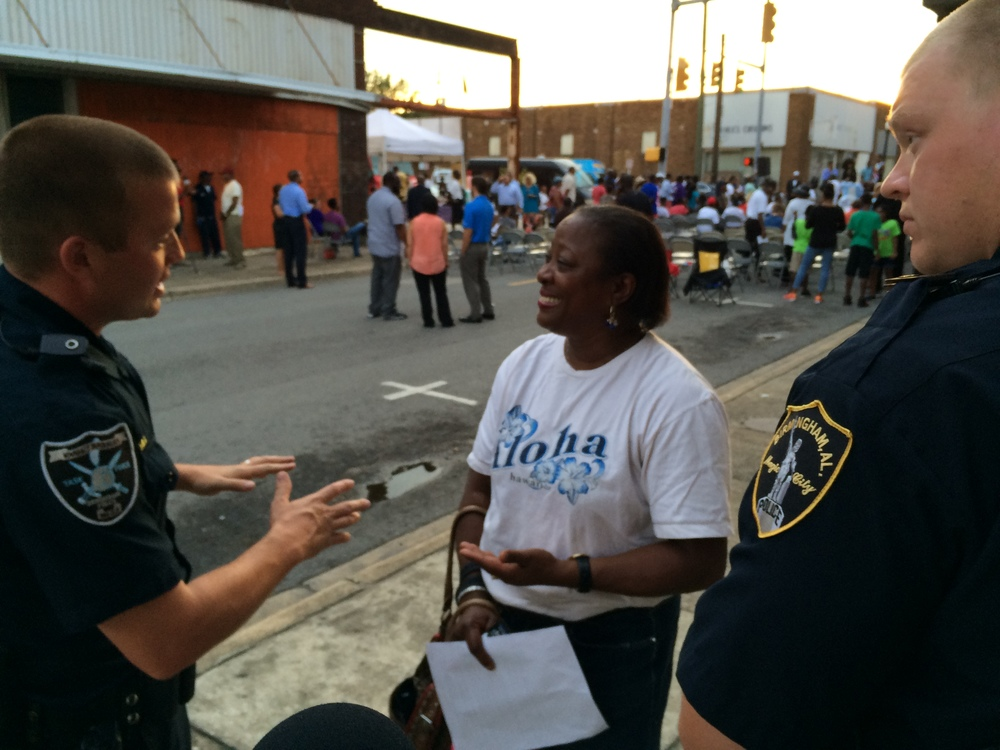 Corliss Cowart (center) talks with Officer Brandon Hill (left). Credit: Rachel Osier Lindley