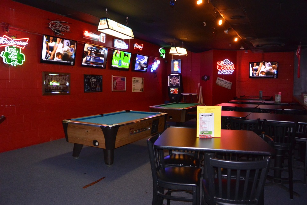 The Mezzanine Seats 42, with 2 Pool Tables, 1 Dart Board , and 5 Plasma TV's.