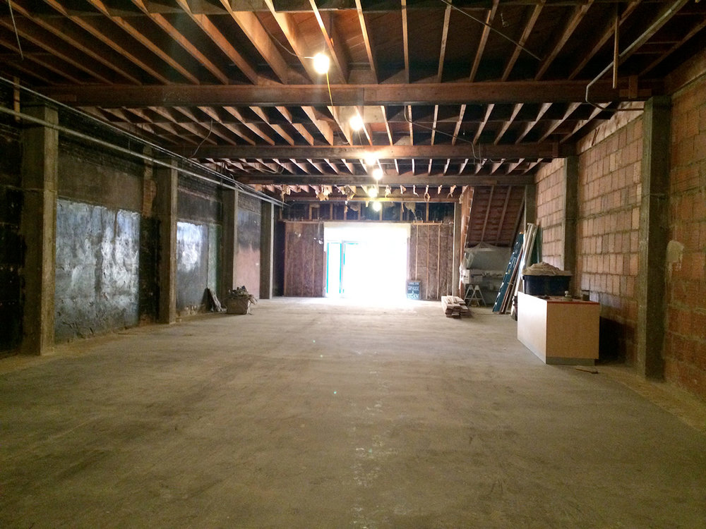Before: A completely gutted retail space ready for construction.