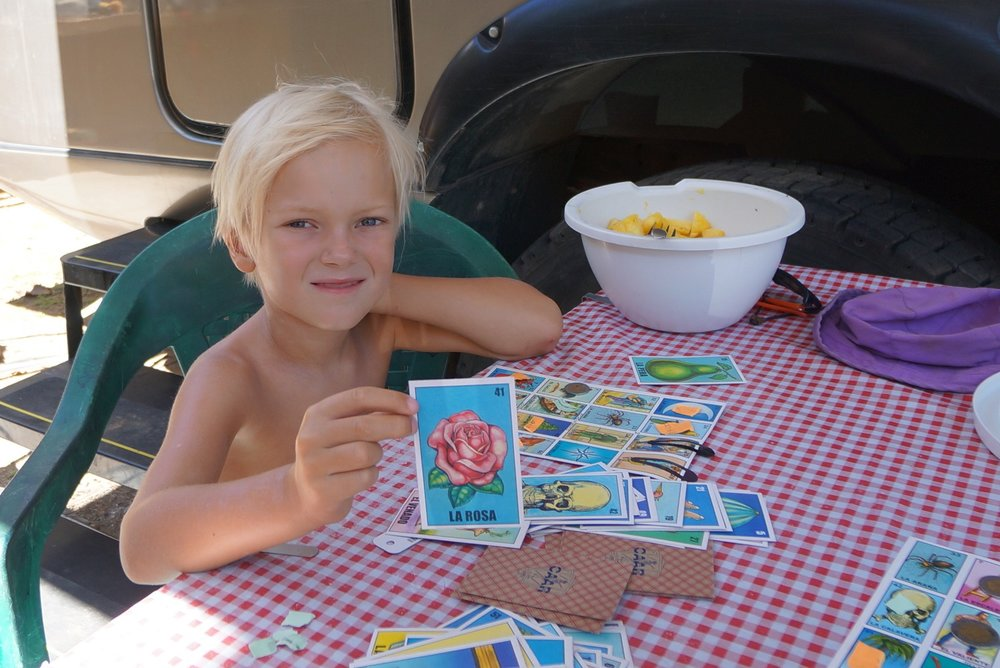 Playing a Spanish words game while camping in Sayulita.